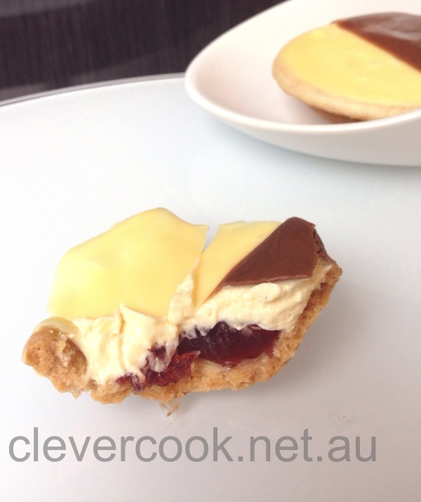 Silky vanilla butter cream with a burst of tart pomegranate jelly. Mmm sublime!
